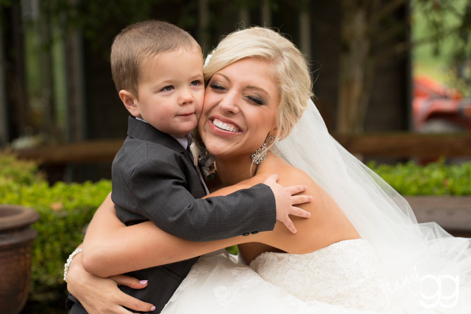 ringbearer with bride at hidden meadows