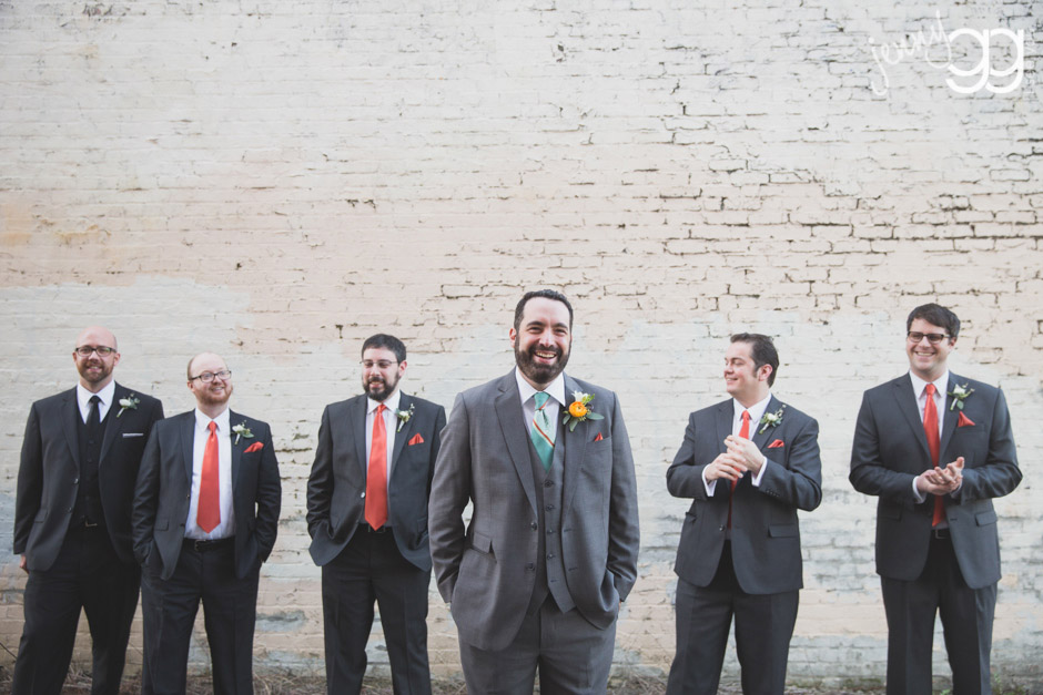 groom with attendants in alley at aerie ballroom by jenny gg