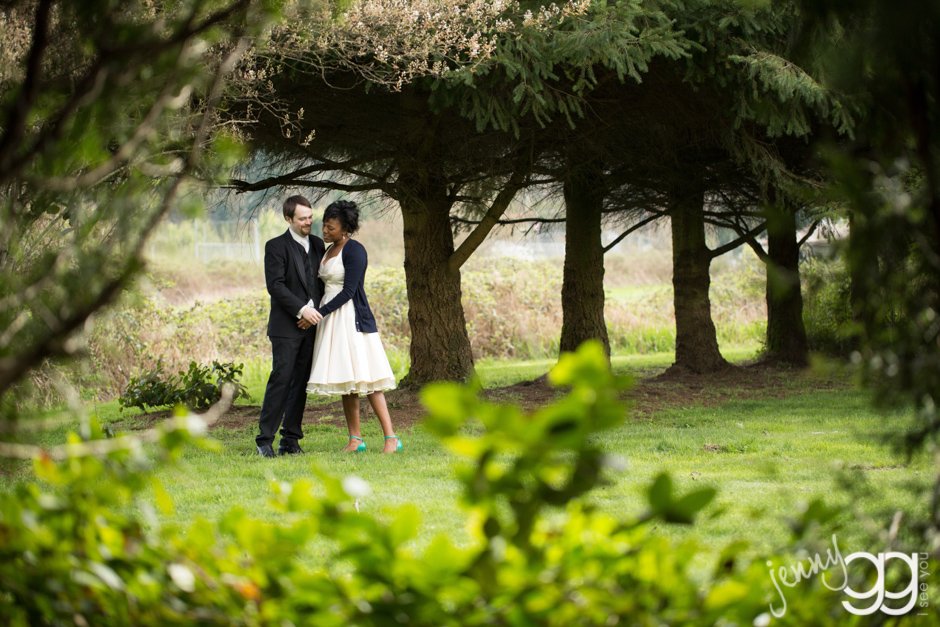 bride and groom on grounds at willows lodge