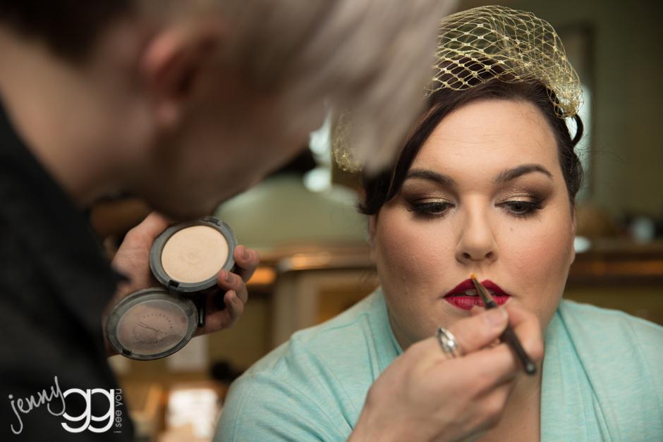 bride getting makeup at edgewater wedding