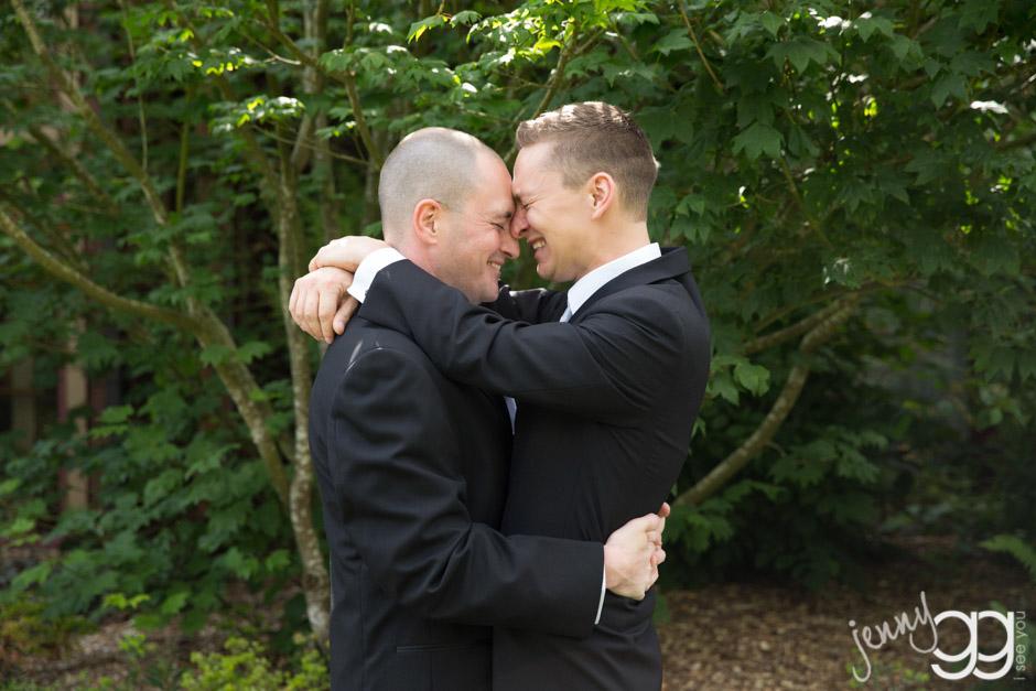 grooms having their first look