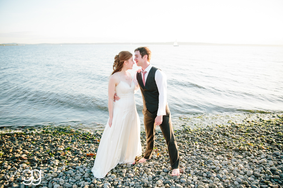 bride and groom at waterline at beach