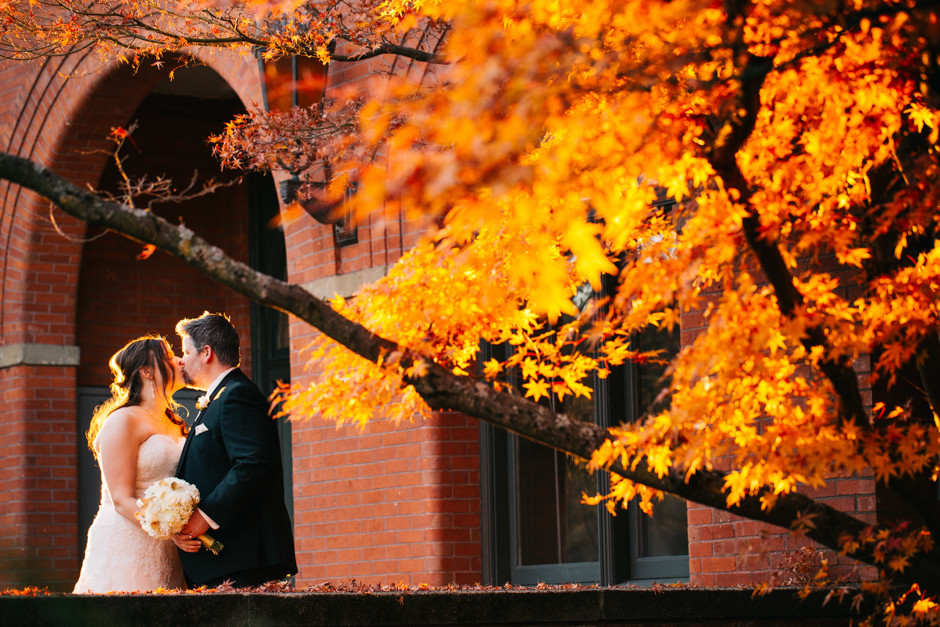 bride and groom at UW in fall by jenny gg